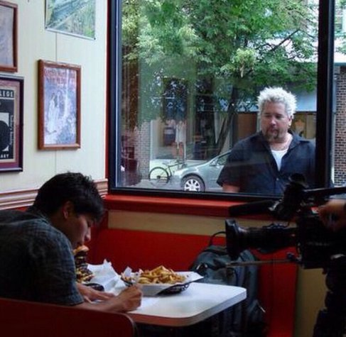 Guy Fieri looking through window